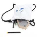 Rucksack mit Stiften und Haus